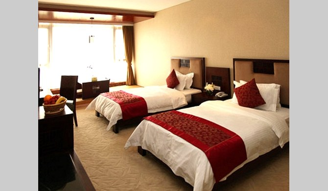 青岛即墨市即墨天泰温泉酒店豪华标准间-卧室